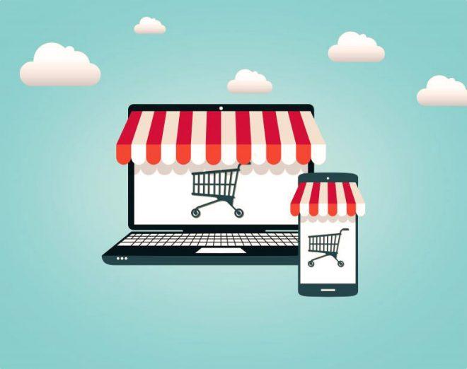 Il disegno di un computer portatile e di uno smartphone che mostrano sullo schermo un carrello.